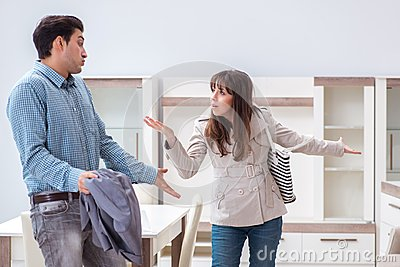 The young couple disappointed with price in furniture store