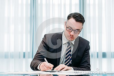 Handsome successful business man working office