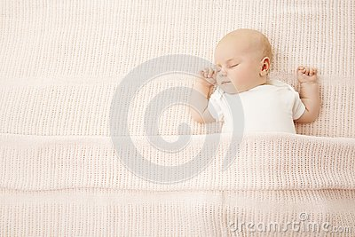 Baby Girl Sleep in Bed, Newborn Child Covered Knitted Blanket