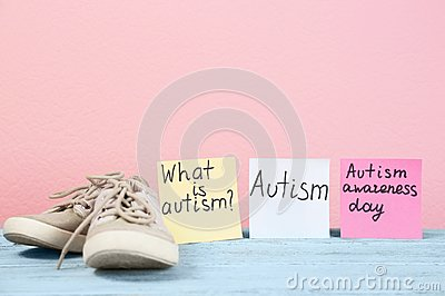Notes with autism related phrases and child trainers