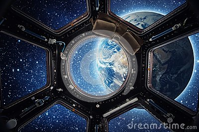 Earth and galaxy in spaceship international space station window