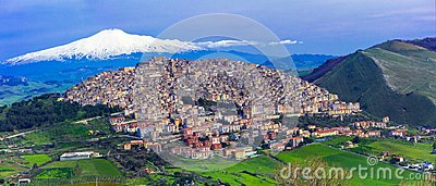 Amazing village Gangi with Etna volcano behind in Sicily, Italy