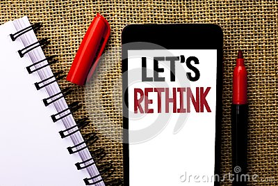 Handwriting text Let Us Rethink. Concept meaning Give people time to think things again Remodel Redesign written on Mobile Phone o