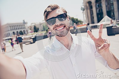 Close up portrait of cheerful handsome delightful excited glad j