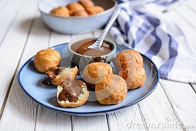 Bunuelos - traditional Colombian deep fried pastry with chocolate sauce