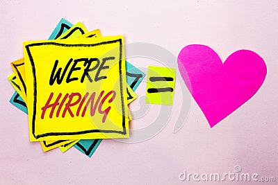 Text sign showing We're Hiring. Conceptual photo Recruiting Hiring Now Recruitment Vacancy Announced Hire written on Yellow Stick