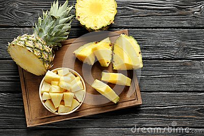 Wooden board with fresh sliced pineapple