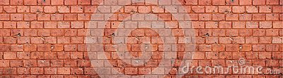 Old and weathered grungy red brick wall texture background in wide panorama format