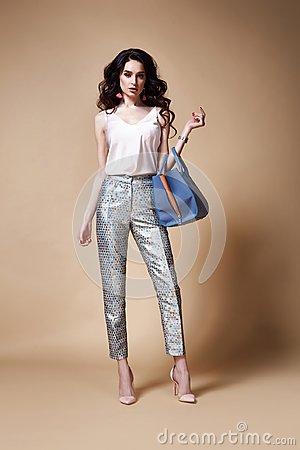 beautiful woman fashion glamour model brunette hair makeup wear silk blouse trousers clothes for every day casual party style