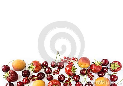Mix berries isolated on a white. Ripe apricots, red currants, cherries and strawberries. Berries and fruits with copy space for te