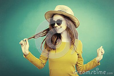 Travel concept - Close up Portrait young beautiful attractive ginger red hair girl with trendy hat and smiling. Duotone