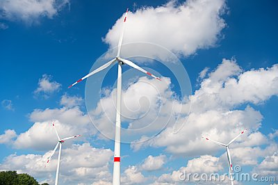 Wind turbine on cloudy blue sky. Alternative energy and electricity source. Global warming. climate change and ecology. Eco power
