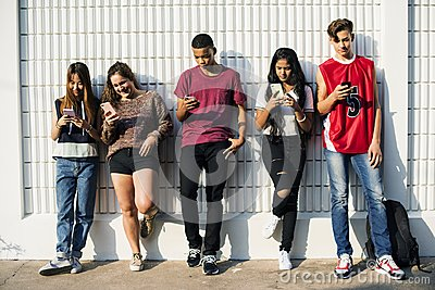 Diverse teenagers with their mobile phones