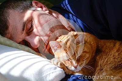 Man napping with cat