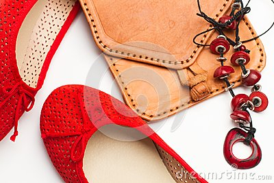 stock image of a pair of red shoes and a handbag