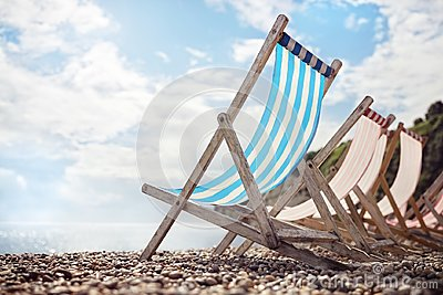 Summer vacation deck chairs on the beach at the seaside