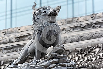 Lion sculpture on a temple roof