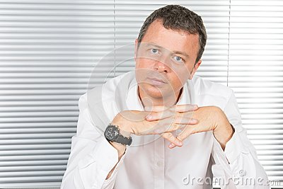 middle aged businessman portrait in the office