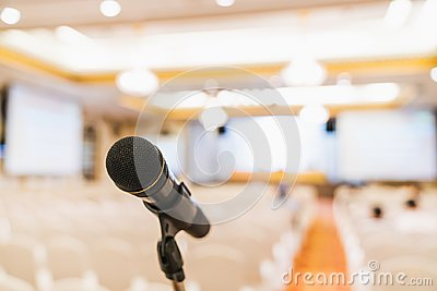 Microphone stand in conference hall blurred background with copy space. Public announcement event, Organization company meeting