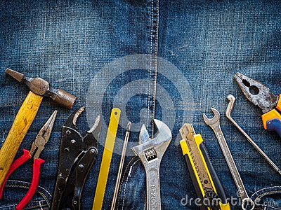 Joinery tools on a jean texture background. Labor day concept.