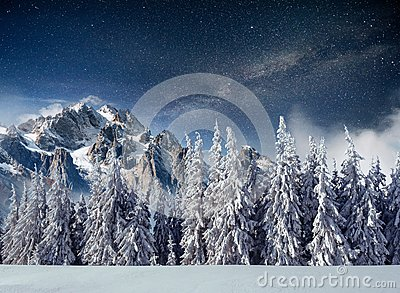 Fantastic winter meteor shower and the snow-capped mountains. Carpathians. Ukraine, Europe
