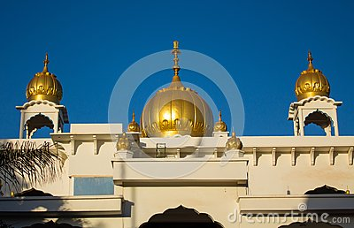 Sikh temple golden domes gleam in the sun
