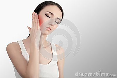 Woman In Pain. Closeup Of Beautiful Young Woman Feeling Painful Toothache, Touching Face With Hand. Sad Stressed Girl Feeling Stro