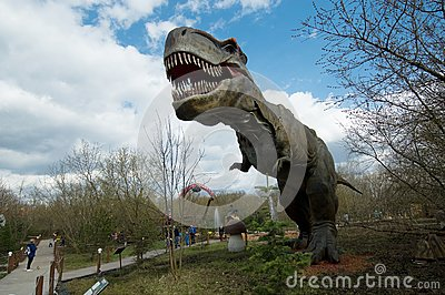 People near the Tyrannosaur Rex in Dinosaur Park, Moscow, Russia