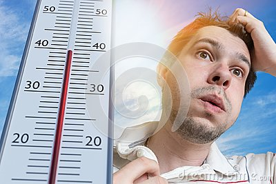 Hot weather concept. Young man is sweating. Thermometer is showing high temperature. Sun in background