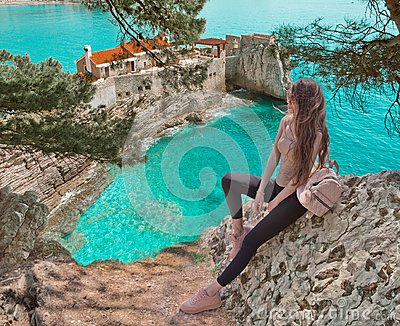 Tourist girl visiting Montenegro. Traveller sightseeing Old Venetian Castello Fortress is attraction symbol of the Montenegrin to