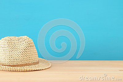 Fedora hat over wooden table.