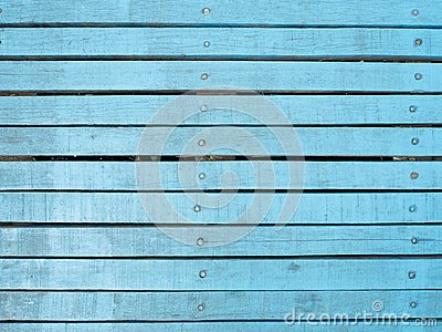 Vintage wood of background texture with knots and nail holes.