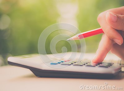 Soft focus retro woman hand working with calculator
