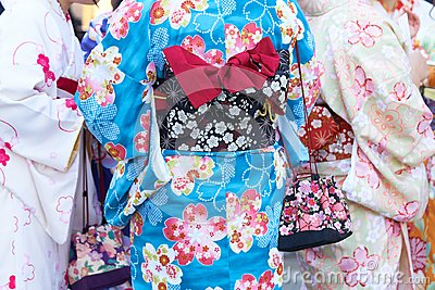 Young girl wearing Japanese kimono standing in front of Sensoji Temple in Tokyo, Japan. Kimono is a Japanese traditional garment.
