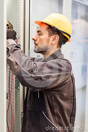 Electrician engineer tests electrical installations on relay pro