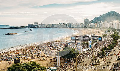 Aerial view of a crowded pre-NYE party Copacabana Beach in Rio de Janeiro, Brazil. The beach is 4km long and is one of