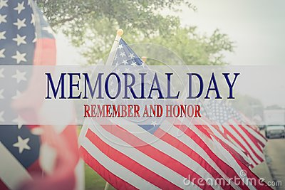 Text Memorial Day and honor on row of lawn American Flags