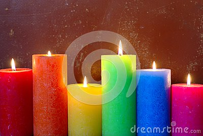Burning Candles In Rainbow Colors