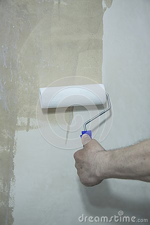 Process of priming plastered surface