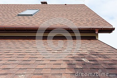 Roofing construction and building new house with modular chimney, skylights, attic, dormers and eaves.
