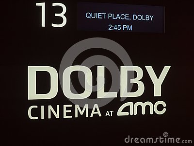 Dolby Cinema at AMC certification logo outside of a movie theater entrance