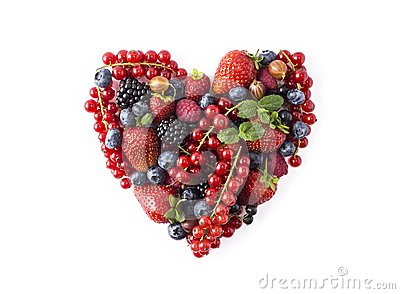 Heart shape assorted berry fruits on white background. Berries in heart shape isolated on a white. Ripe blueberries, red currants,