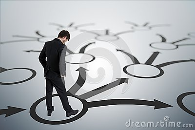 Young unsure man is making decision. Strategy and choice concept