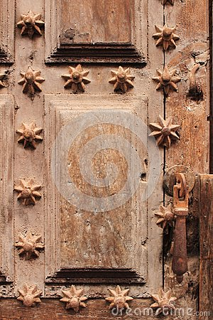Old wooden door with wrought iron details stair shaped