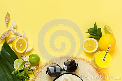 Straw foman`s hat, sun glasses and beach accessory with detox citrics water on yellow. Top view. Flat lay. Copy space.
