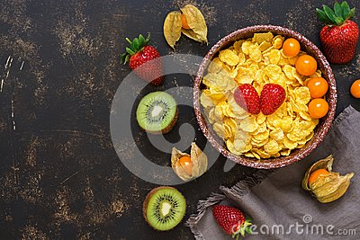 Corn flakes with fresh berries and fruits. Top view, space for text.