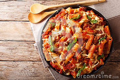 Pasta ziti with bolognese sauce and cheese close-up. horizontal