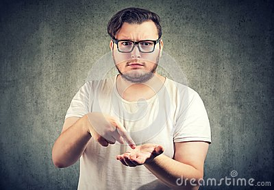 Serious chubby man asking for more money to pay back debt