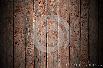 The texture of an old rustic wooden fence made of flat processed boards. Detailed image of a street fence of a rustic type made o