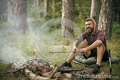 Hipster man with beard happy smile and roast sausages